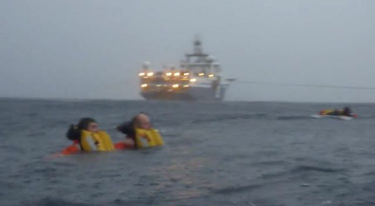 Survivors in the Water - Note the Streamer Tow Cables (Credit: Passenger Video)