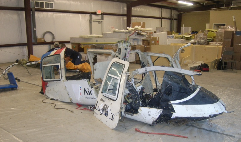 Wreckage of Rotorcraft leasing Company (RLC) B206L4 N180AL (Credit: NTSB)  Note: Decals over the name of the former owner have come loose after the exposure to sea water.
