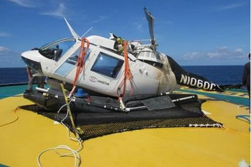 Wreckage of B206B N1060C on the Deck of a Fishing Vessel in the Pacific (Credit: Operator via NTSB)