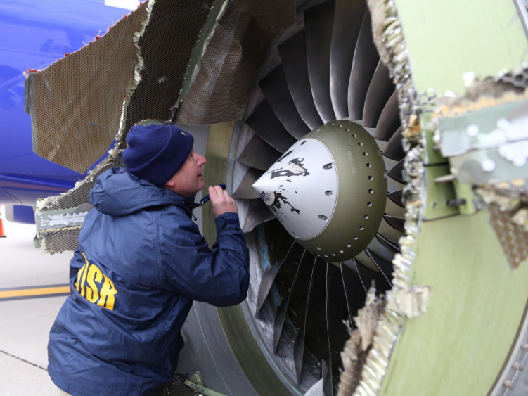 Investigators examine damage to Southwest B737-800 N772SW No 1 CFM56-7B Engine at Philadelphia (Credit: NTSB)