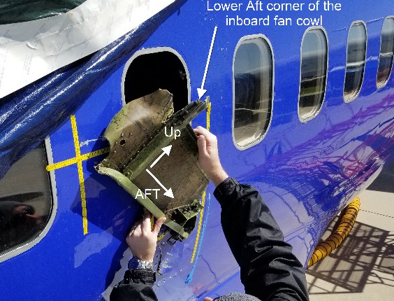 Picture of window 14 with portion of engine inboard fan cowl (Credit: NTSB)