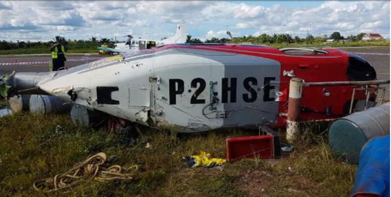 Wreckage of Niugini Helicopters B407 P2-HSE Without Skids (Credit: PNG AIC)