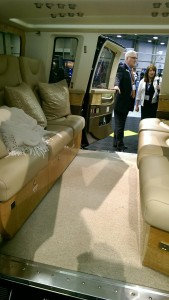 Even Bigger: The Sikorsky S-76D.  Decent leg room without a third row.  Nice cushions!