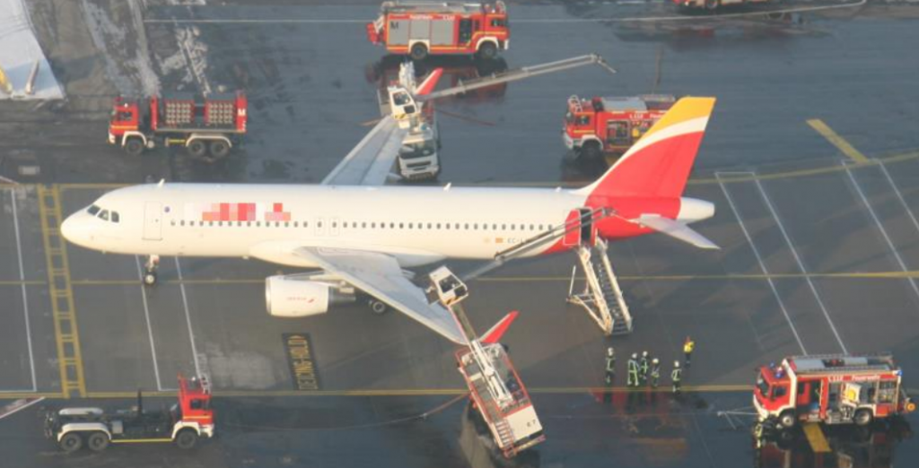 Iberia A320 EC-LVD at Munich in Contact with Two De-icing Trucks (Credit: Police via BFU who have redacted Identifying markings)