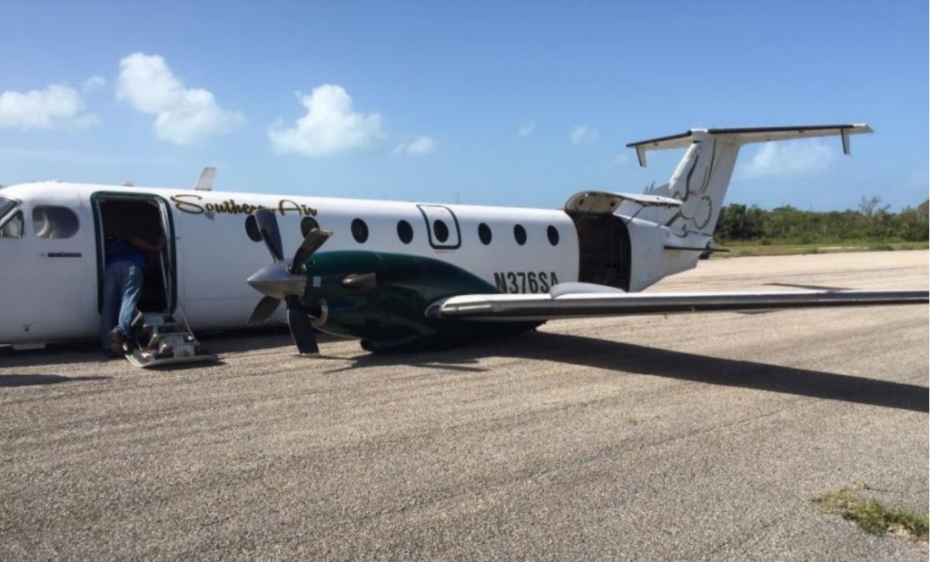 Beechcraft B1900C N376SA of Southern Air Charter After Wheel Up Landing at Deadman's Cay (Credit: Bahamas AAID)