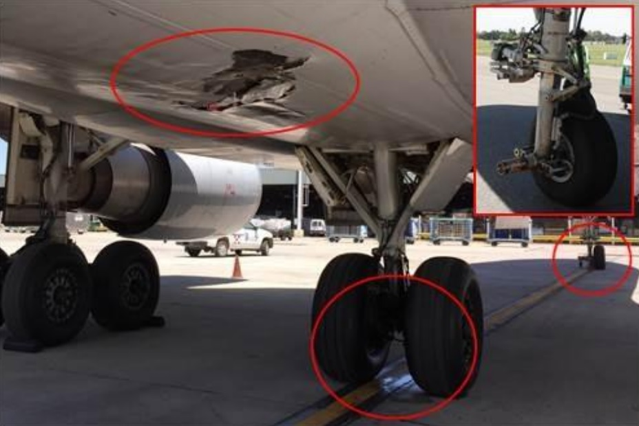 Damage to the Underside of Lufthansa Cargo MD-11F D-ALCM and Missing Nose Wheel (Credit: JIAAC)