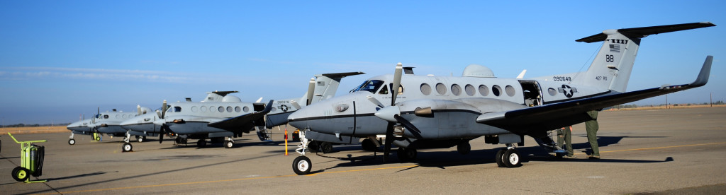 Three MC-12W on the Flightline at Beale AFB, CA (Credit: USAF / Senior Airman Shawn Nickel)
