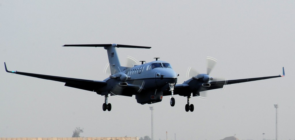 USAF Beechcraft MC-12W Liberty ISR King Air 350 Landing Showing the Large Ventral Pod with FLIR Turret Retracted.  Note this aircraft does not feature the Dorsal SATCOM Antenna (Credit: USAF / Senior Airman Tiffany Trojca)