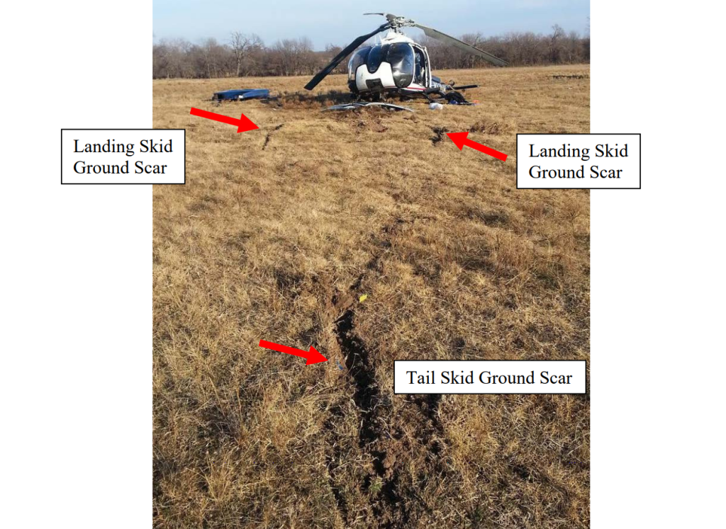 Wreckage of Air Methods EC130B4 HEMS Helicopter N334AM After Ice Ingestion and Power Loss Showing Ground Scars (Credit: NTSB)