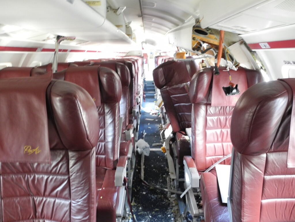 PenAir Saab 2000 N686PA Unalaska, with Displaced Seat 4A (location of fatality) and Yellow Arrow Marking the Blade at Seat 4G (Credit: NTSB)