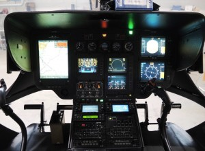 EC135 Cockpit: The large display on the left is  operated by the HEMS crew member. He can  choose to view the  moving map on the entire display, as shown in the picture, or to split the display, as shown for the pilot on the right. A third possibility is that the display on the left shows flight instruments on the top half and the moving map on the lower half of the display (Credit: AIBN)