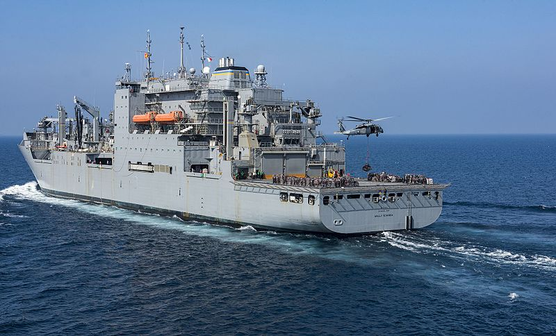 Lewis and Clark-class dry cargo and ammunition ship USNS Wally Schirra (T-AKE 8) in the Pacific in 2017 with a MH-60S Sea Hawk under taking VERTREP (Credit: US Navy / Mass Communication Specialist 2nd Class Sean M. Castellano)