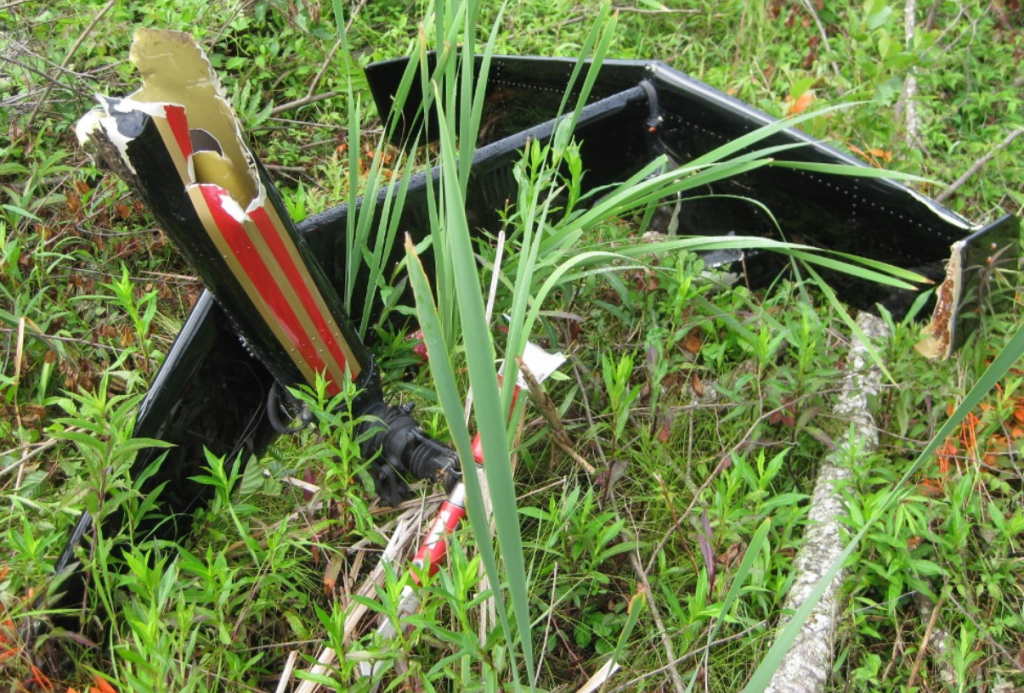 Severed Tail of Haverfield Aviation Hughes 369E N765KV after HESLO Fuel Exhaustion Accident (Credit: FAA via NTSB)