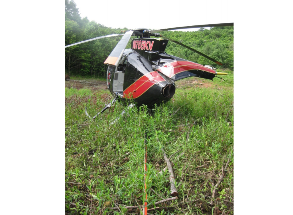 Wreckage of Haverfield Aviation Hughes 369E N765KV after HESLO Fuel Exhaustion Accident (Credit: FAA via NTSB)