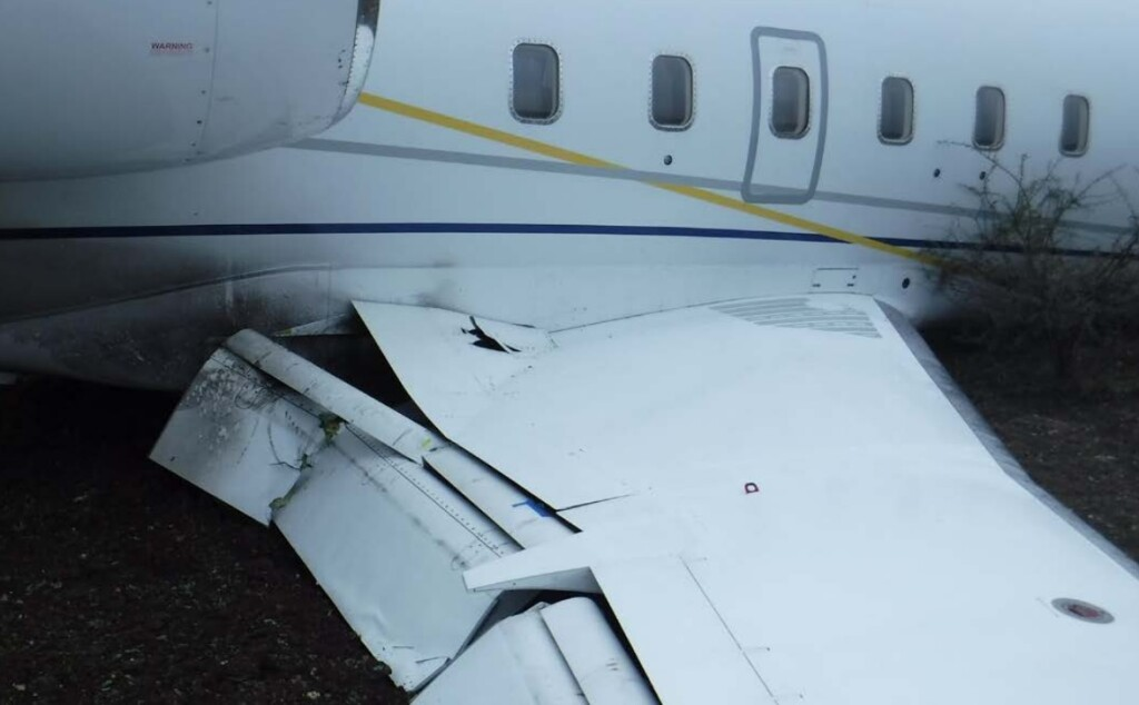 Damaged Wing of Canadair CL600 Challenger N813TW at Ox Ranch, TX (Credit:  Lone Star Removal via NTSB)