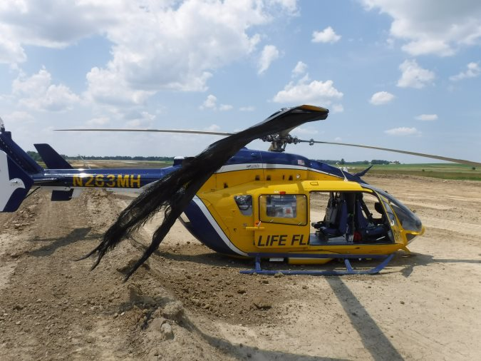 Metro Aviation HEMS Airbus Helicopters BK117C2 / H145 N263MH at Wayne County Airport (KBJJ), Wooster, Ohio After Hard Landing, Tangle in Silt Fencing (Credit: NTSB)