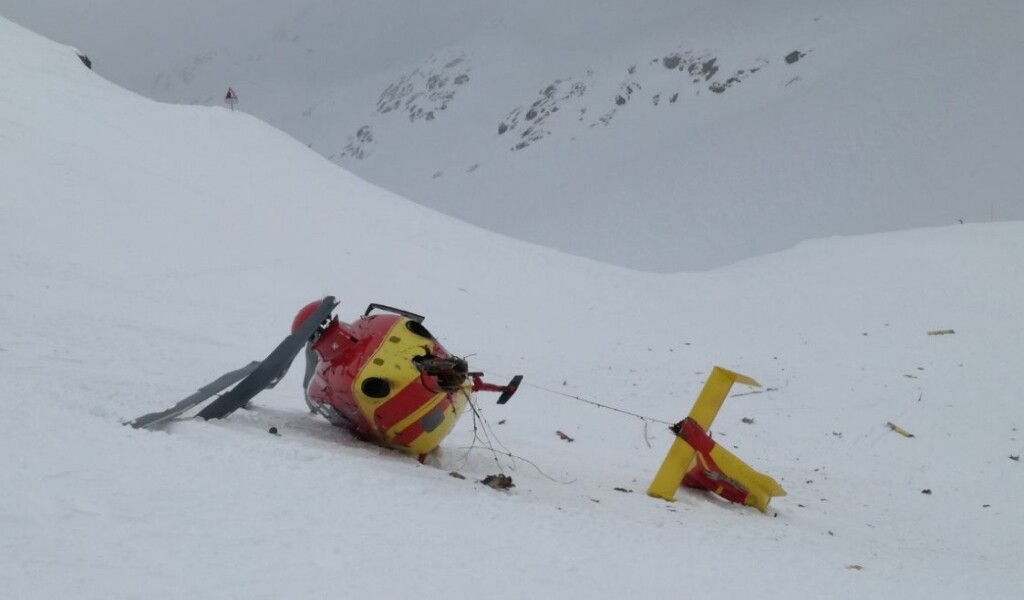 Wreckage of Air Glaciers Airbus Helicopters EC135T1 HB-ZIR at Col du Grand St-Bernard: The Road Sign Used for Visual Reference is Visible Top Left (Credit: SUST)