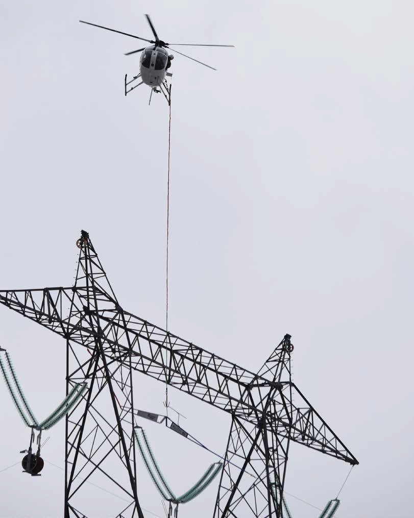 Rogers Helicopters MD 530F (369FF) N530KD Over an Electricity Pylon (Credit: via NTSB)