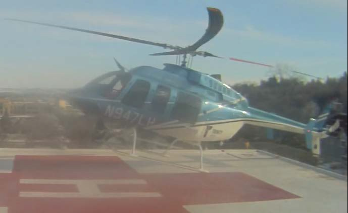 Still from Security CCTV of the Landing of Bell 407 N947LH at the Trinity Medical Helipad (Credit: via NTSB)
