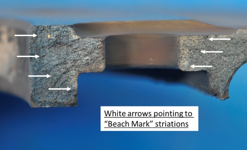 Fracture Surface Low Cycle Fatigue (LCF)( Beach Marks on Gas Generator Turbine Static Disc from Honeywell T53 of Iron Eagle Bell UH-1B Logging Helicopter N64RA (Credit: NTSB)