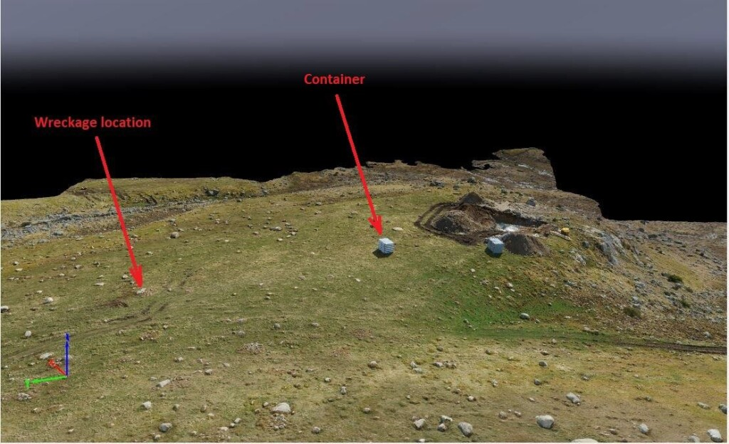 3D illustration of the accident site, looking southeast, the day after the wreckage was removed. The arrow on the left points to the rock on which the helicopter was lying. The hole in the ground is for pylon 155. A rocky outcrop and steeply sloping terrain can be seen on the far right. (Credit Nordic Unmanned via NSIA)